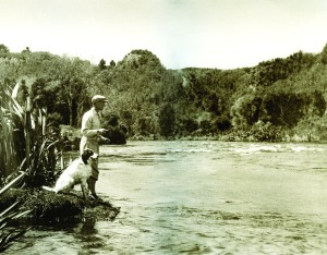 Alan Pye with his dog Major, fishing the Waikato River, 1931