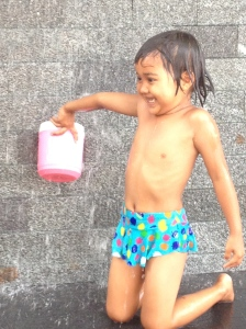 This little girl was taking her bath, mid-morning, in the middle of Bangkok