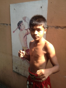 While this little boy was practising his Muay Thai boxing late afternoon