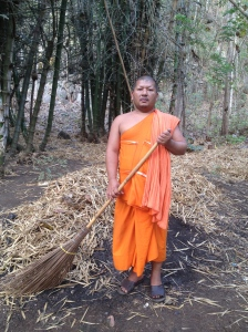 Late afternoon, I found this monk was sweeping in the Mon village along the River Kwai